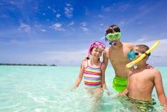 Happy Children in Ocean Stock Photography