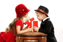 Happy children opening gift. Present for a birthday, valentine's day or other holiday. Isolated on white background Royalty Free Stock Images