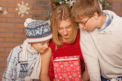 Happy Children Opening Gifts. New Year. Royalty Free Stock Photos