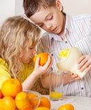 Happy Children with oranges stock photos