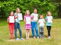 Happy children outdoors Stock Photos