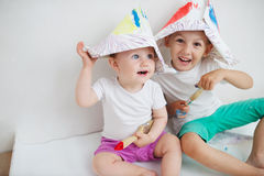 Happy children painting wall at home Stock Photos