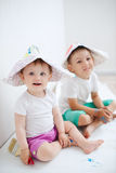 Happy children painting wall at home Royalty Free Stock Photos
