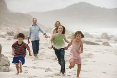 Happy Children With Parents On Beach Stock Photos