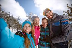 Happy children with parents on skiing Stock Images