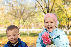 Happy children picking flowers Royalty Free Stock Images