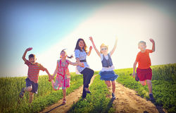 Happy children play on field Royalty Free Stock Photo