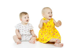 Happy children play on the floor royalty free stock photography