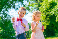 Happy children play with soap bubbles Royalty Free Stock Images