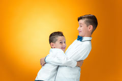 Happy children playfully fighting Royalty Free Stock Photos