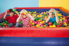 Happy children playing in ball pool Royalty Free Stock Images