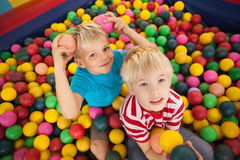 Happy children playing in ball pool Royalty Free Stock Photography