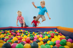 Happy children playing in ball pool. At a party Royalty Free Stock Image