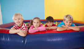 Happy children playing in ball pool Royalty Free Stock Photos