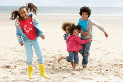 Happy children playing on beach Stock Image