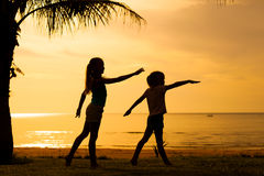 Happy children playing on the beach Stock Photography