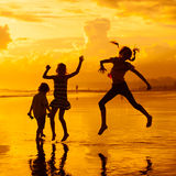 Happy children playing at the beach Royalty Free Stock Photos