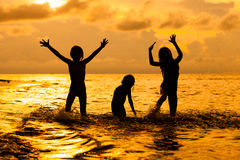 Happy children playing at the beach Stock Photo