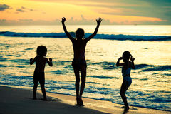 Happy children playing at the beach Royalty Free Stock Image