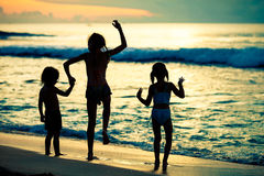 Happy children playing on the beach Royalty Free Stock Photos