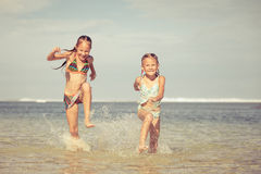Happy children playing on the beach Royalty Free Stock Photography