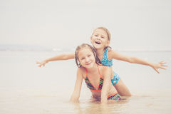 Happy children  playing on the beach Stock Photo