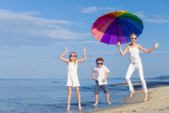 Happy children playing on the beach at the day time. Stock Images