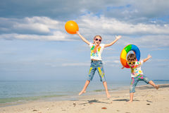 Happy children playing on the beach at the day time. Royalty Free Stock Photo