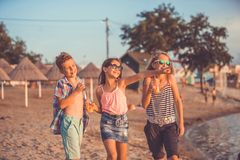 Happy children playing on the beach at the day time royalty free stock photo