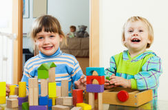Happy children playing with blocks  in home Royalty Free Stock Image