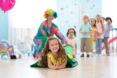 Happy children playing in childrens playroom for birthday party or entertainment centre. Kids amusement park and play royalty free stock photography
