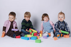 Happy children playing with cubes Royalty Free Stock Image