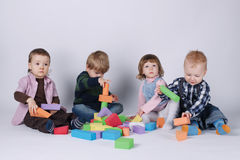 Happy children playing with cubes Stock Image