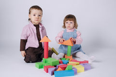 Happy children playing with cubes Stock Photos