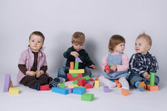 Happy children playing with cubes Royalty Free Stock Photos