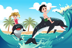 Happy children playing with dolphins in the ocean. A vector illustration of happy children playing with dolphins in the ocean for carefree concept Royalty Free Stock Image