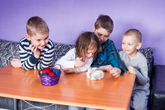 Happy children playing on Easter Stock Photos