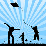 Happy children playing in a field. Vectored illustration of kids playing together in a field with different toys as kites and balls, with butterflies and the sun Stock Photo