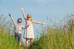 Happy children playing on the field at the day time. Royalty Free Stock Photos