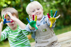 Happy children playing with finger paint Royalty Free Stock Image