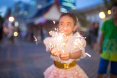 Happy children playing with fireworks. Stock Image
