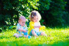 Happy children playing in the garden with toy balls Stock Image