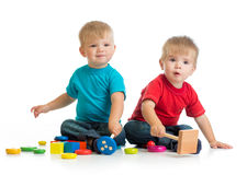 Happy children playing by mallet. Or hammer royalty free stock image