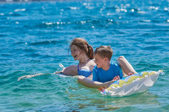 Happy Children Playing with Mattress at Sea Royalty Free Stock Photo