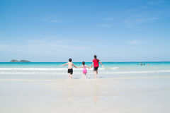 Happy Children playing in the Ocean Royalty Free Stock Image