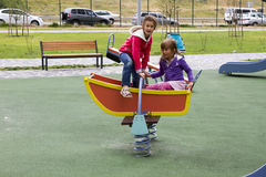 Happy children playing outdoors. Against the gray sky Stock Photos