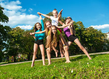 Happy children playing outdoors Stock Photography