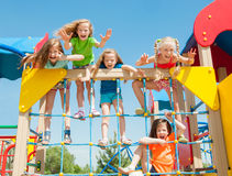 Happy children playing outdoors royalty free stock photo