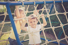 Happy children playing on the playground Stock Image