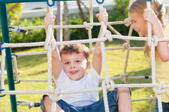 Happy children playing on the playground Royalty Free Stock Image